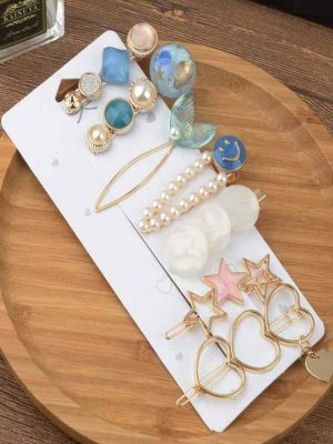 Jewels Galaxy Pearl Gold Plated Hair clips